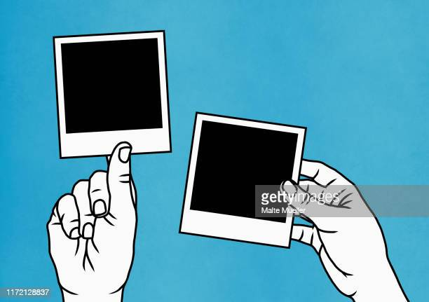 hands holding instant photographs - touching stock illustrations