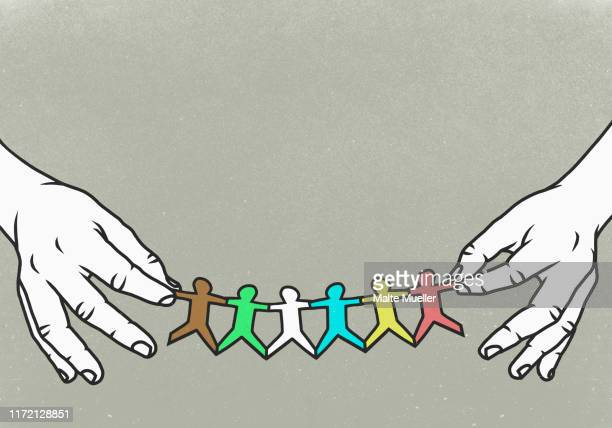 hands holding multi colored paper chain - image technique stock illustrations