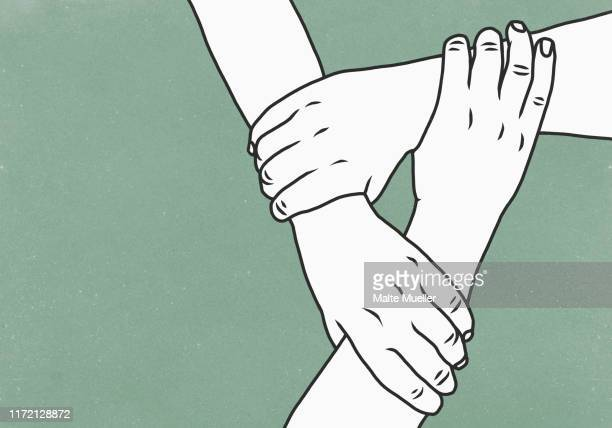 hands holding wrists in support - drei personen stock-grafiken, -clipart, -cartoons und -symbole