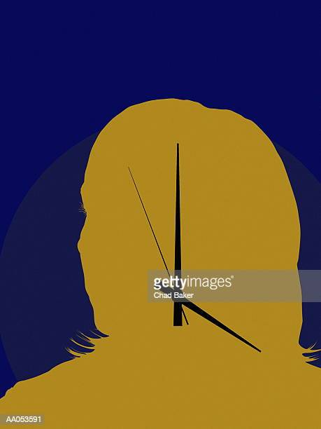 Hands of clock on woman's face