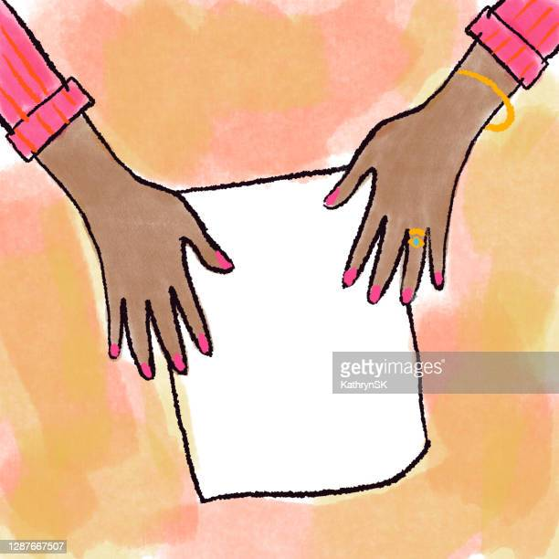 hands of woman with blank paper drawing - kathrynsk stock illustrations