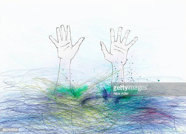 Hands reaching up from underwater