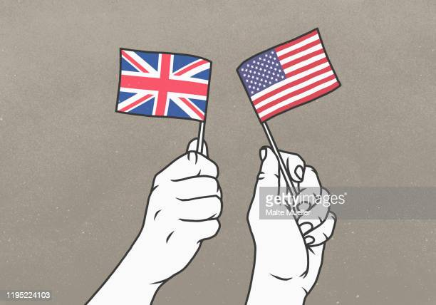 hands waving small british and american flags - image technique stock illustrations