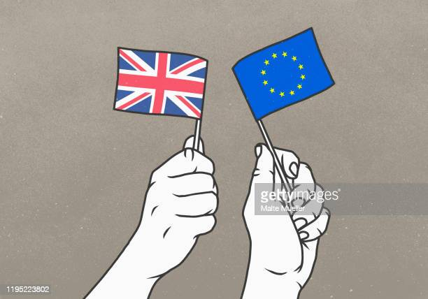 hands waving small british and european union flags - image technique stock illustrations