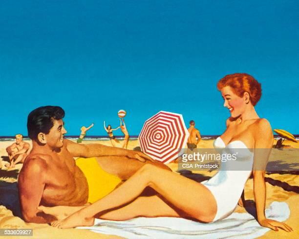 illustrations, cliparts, dessins animés et icônes de couple heureux sur la plage - bain de soleil