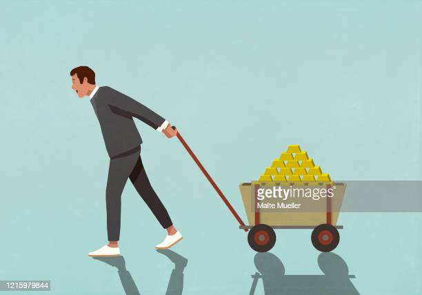 happy male investor pulling wagon full of gold bars - stack stock illustrations