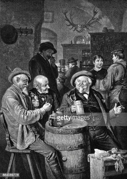 Happy men drinking beer in the restaurant