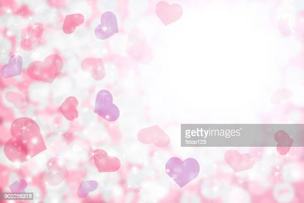 Happy Valentine's Day background of pastel pink, purple hearts and light.