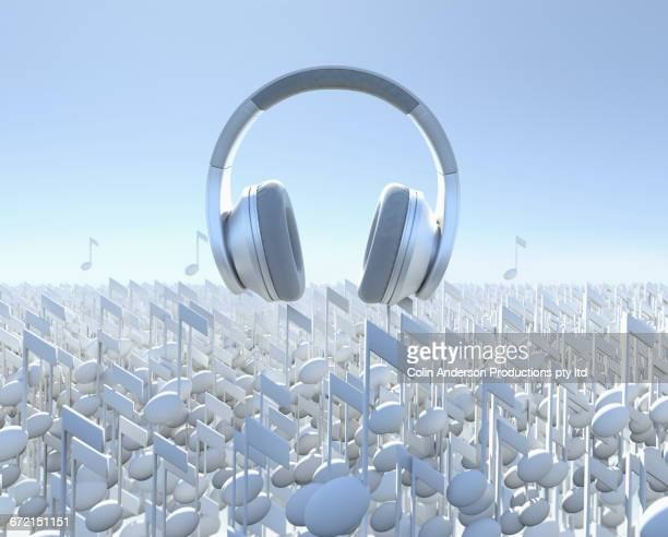 headphones floating over musical notes - group of objects stock illustrations