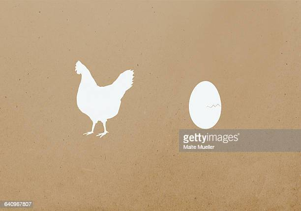 hen and egg against brown background - animal egg stock illustrations, clip art, cartoons, & icons