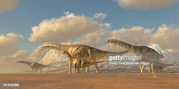A herd of Argentinosaurus dinosaurs walk towards more fertile vegetation to eat, and water to drink.
