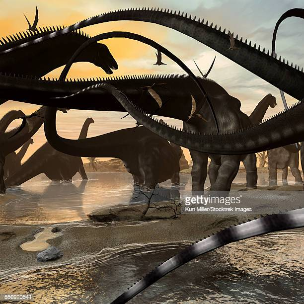 A herd of Argentinosaurus marching along the side of a beach.