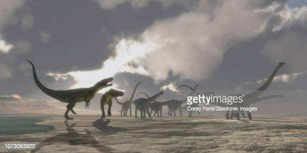 A herd of Diplodocus dinosaurs is chased away from their watering hole.