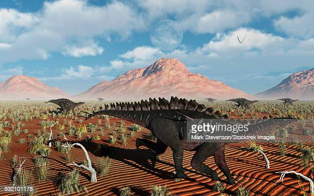 A herd of herbivorous Miragaia dinosaurs migrating during the Jurassic Period.