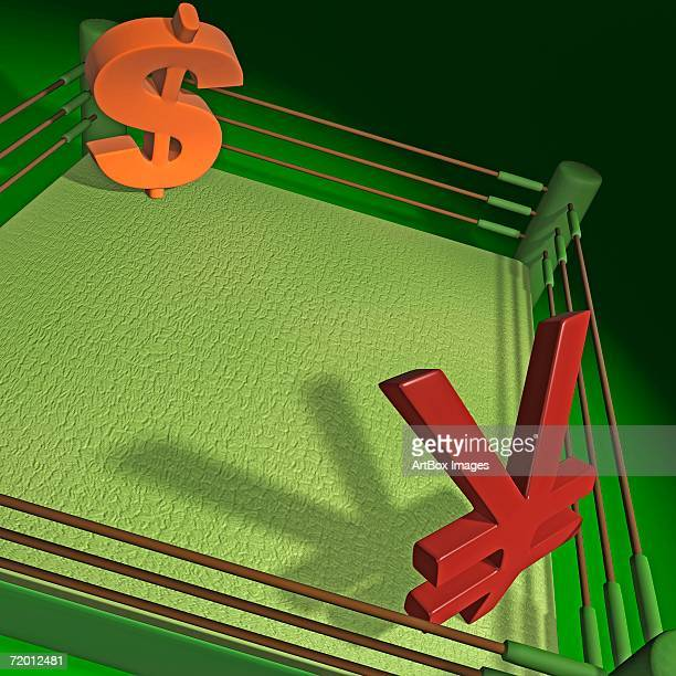 High angle view of a dollar sign and a yen sign in a boxing ring