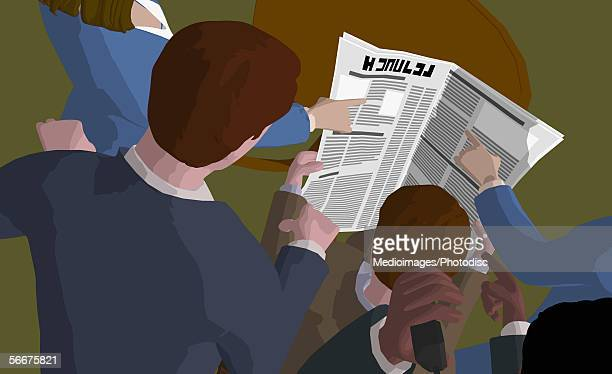 High angle view of business executives reading a newspaper