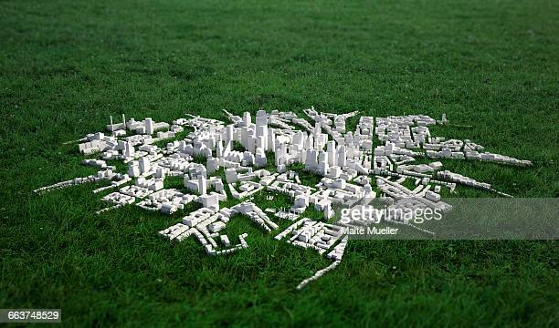 high angle view of cityscape model on grassy field - small stock illustrations