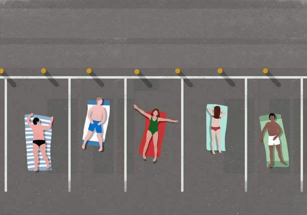 High angle view of people sunbathing in parking lot
