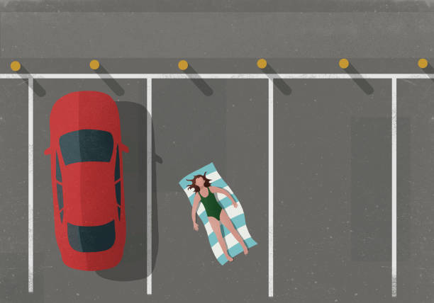 High angle view of woman sunbathing by car in parking lot