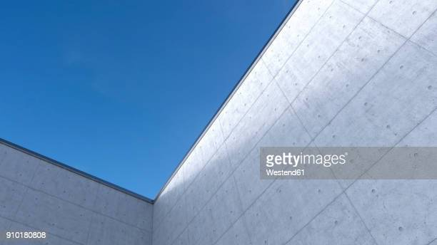 high concrete wall, 3d rendering - facade stock illustrations