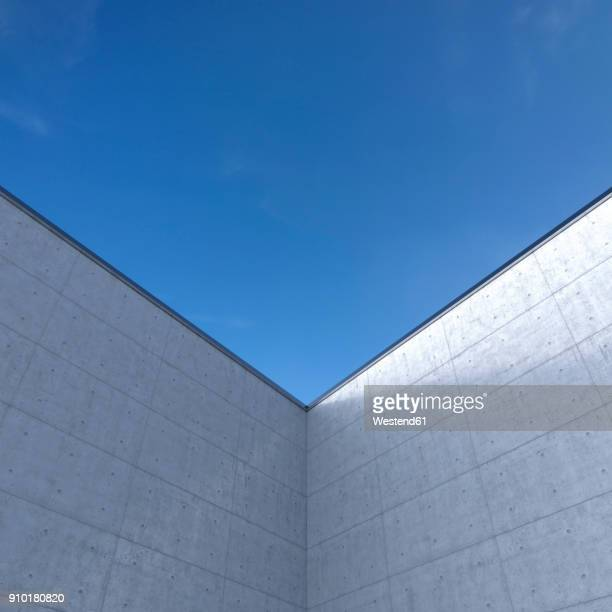high concrete wall in front of blue sky, 3d rendering - corner of building stock illustrations, clip art, cartoons, & icons