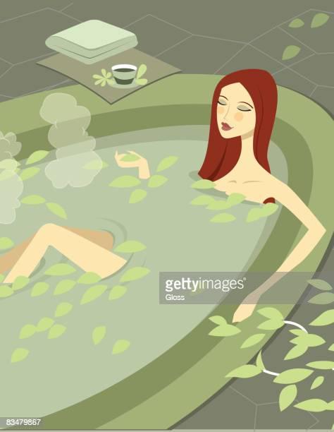high-angle view of a woman soaking in bath tub - attraktive frau stock-grafiken, -clipart, -cartoons und -symbole