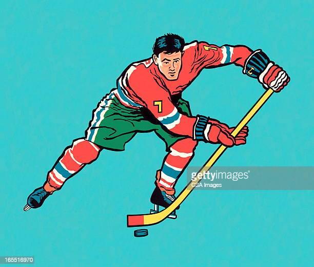 hockey player - ice skating stock illustrations