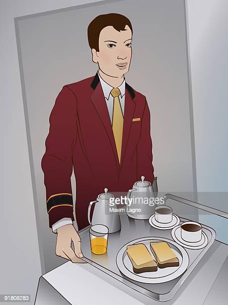 A hotel staff member bringing room service