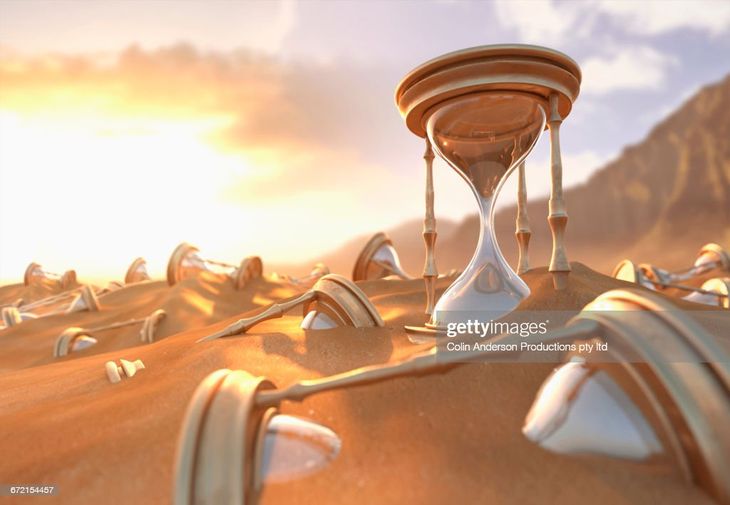 Hourglasses buried in sand at beach : Stock Illustration
