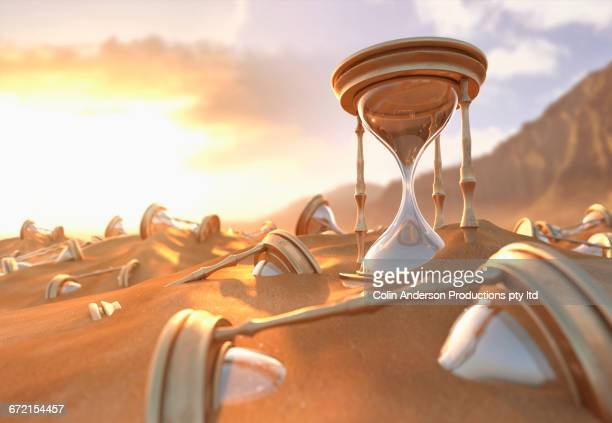 hourglasses buried in sand at beach - day stock illustrations