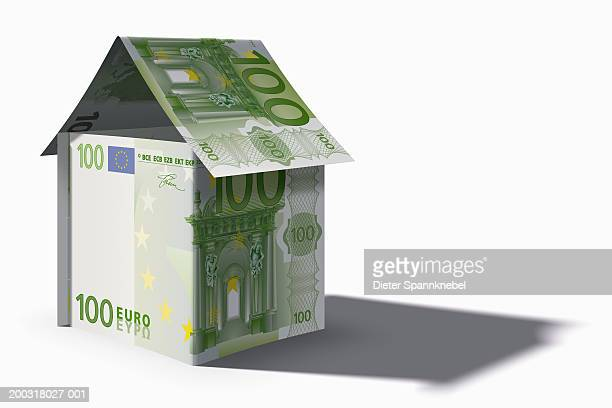 house built from 100 euro notes (digital) - european union euro note stock illustrations, clip art, cartoons, & icons