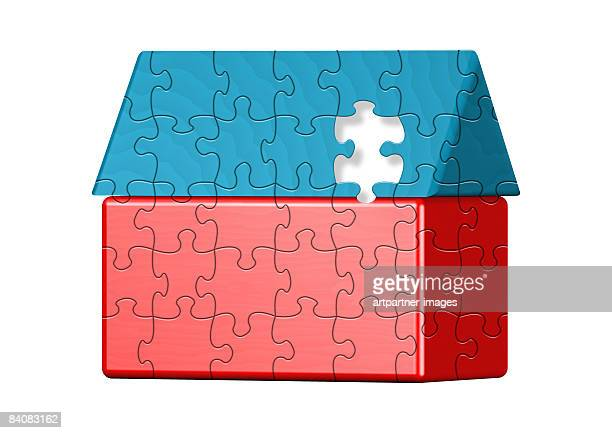 house made of puzzle parts, one part missing - housing development stock illustrations