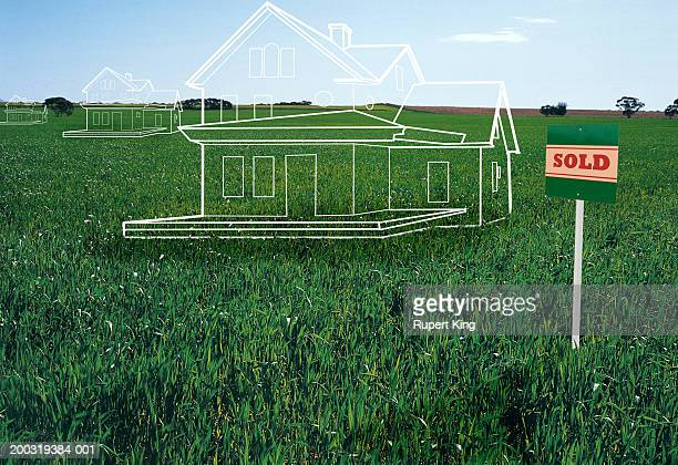 House plans on lawn by 'sold' sign (digital composite)