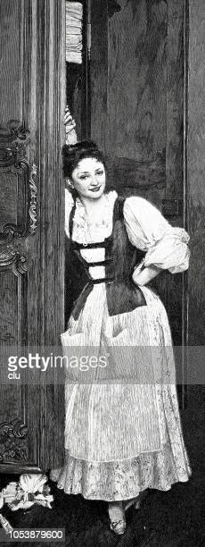 Housemaid posing at the cupboard door during laundry storage