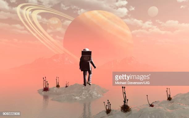 Human Astronaut On Saturns Moon Titan.