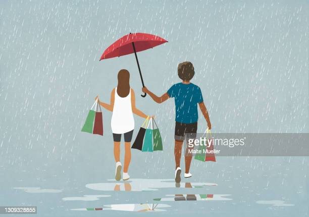 husband holding umbrella over wife with shopping bags in rain - rear view stock illustrations