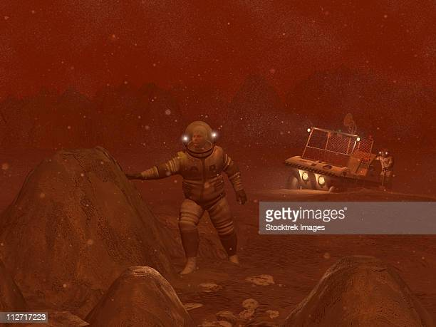 Illustration of astronauts exploring the surface of Saturn's moon Titan during a blizzard.