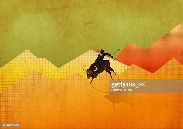 illustration of businessman riding bull on graph representing stock market's ups and downs - bull market stock illustrations, clip art, cartoons, & icons