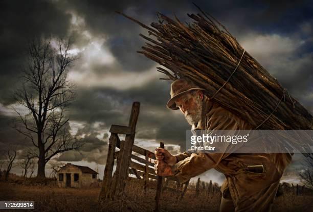 Illustration of Caucasian man carrying wood bundle on back