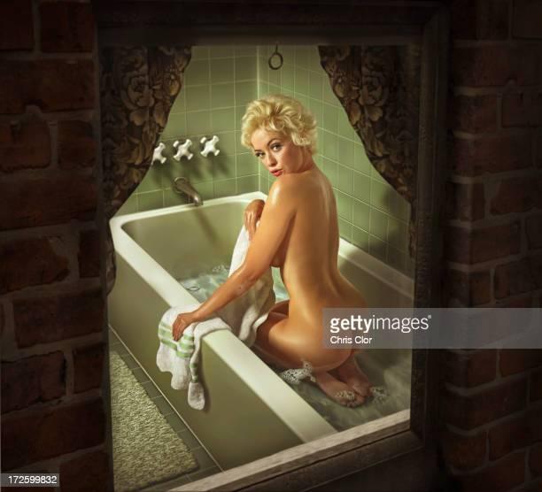 Illustration of Caucasian woman washing in bathtub