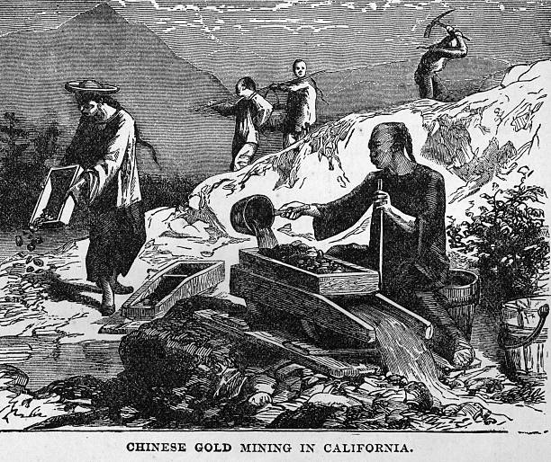 Illustration of Chinese workers gold mining by a mountain...