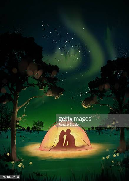 illustration of couple kissing in tent at dawn - aurora borealis stock illustrations