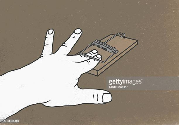 Illustration of fingers in mousetrap against colored background representing trapped