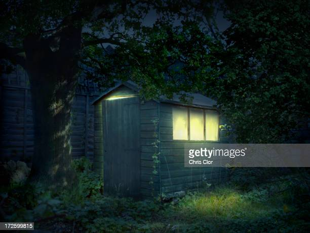 Illustration of illuminated shed in garden