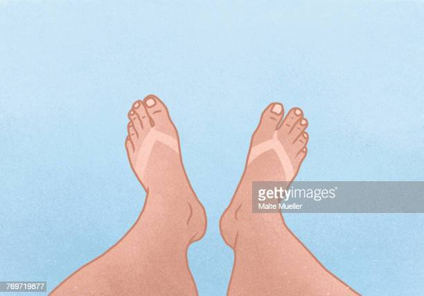 Illustration of legs with tan line against blue background