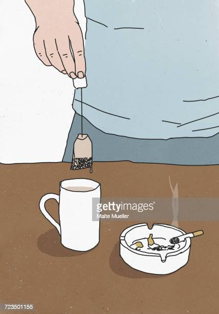 Illustration of man holding teabag above cup by ashtray on table