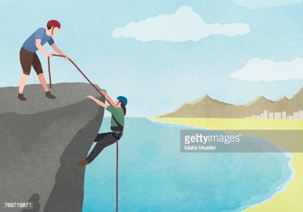 illustration of man pulling woman with rope on cliff against sky - friendship stock illustrations