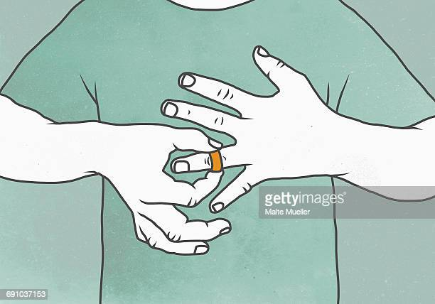 Illustration of man removing wedding ring representing relationship difficulties
