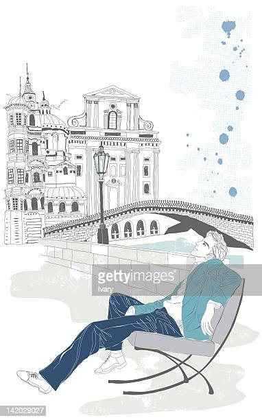 Illustration of man sitting on chair in front of built structure