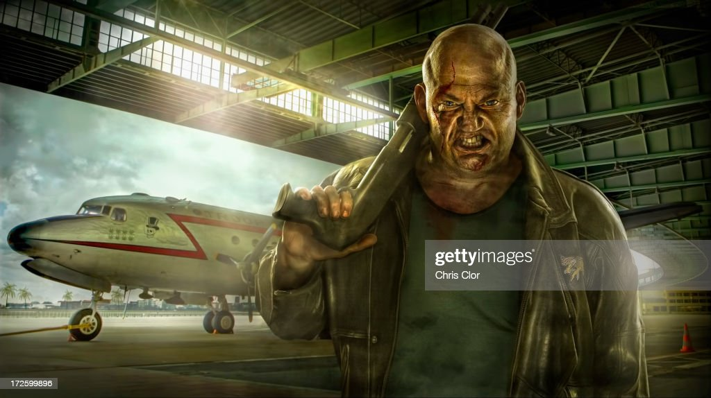 Illustration of mixed race man holding gun in airplane hangar : Stock Illustration